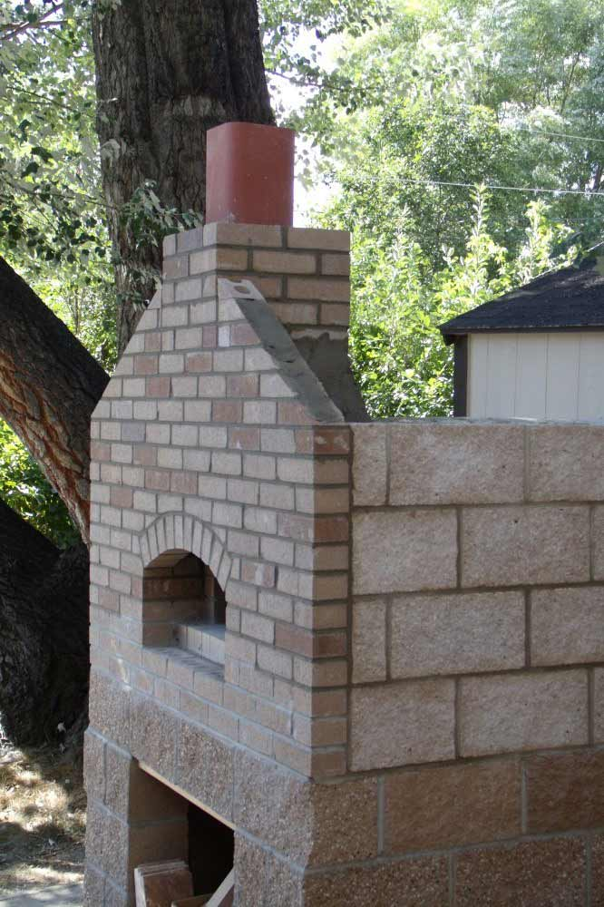 com outer walls and chimney flue on the wood fired brick pizza oven